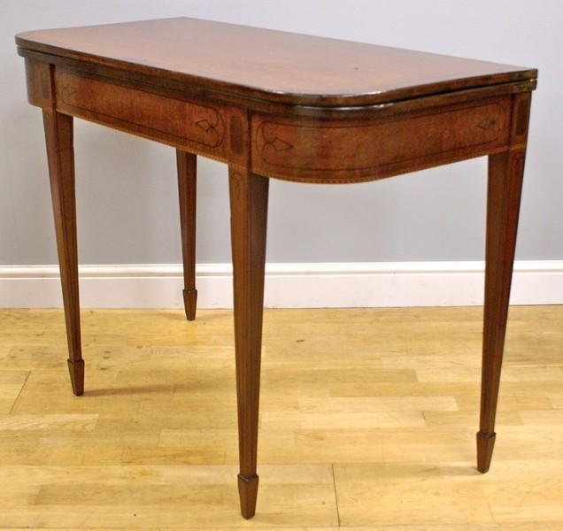 A George Iii Mahogany Inlaid Tea Table