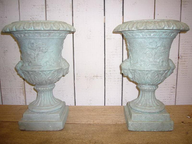 Pair Of Plaster Urns.