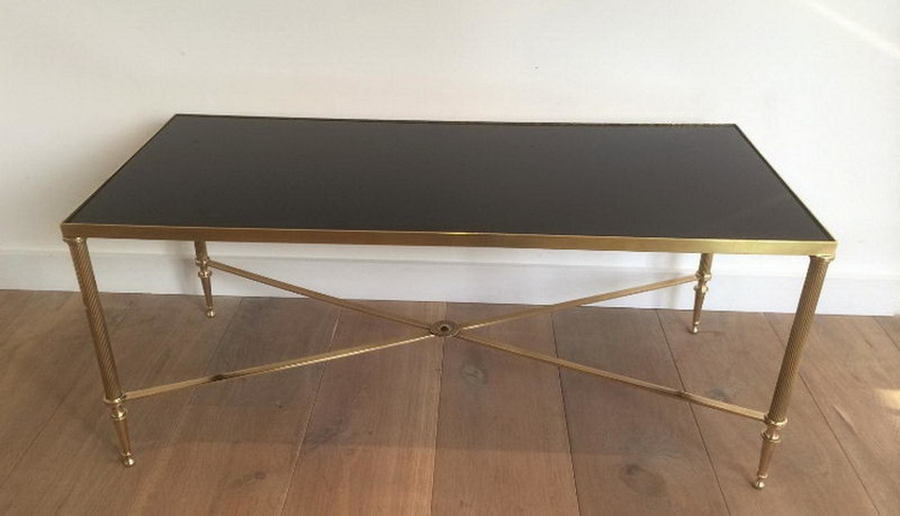 Attributed To Maison Jansen. Elegant Brass Coffee Table With Black Lacquered Top. Circa 1940